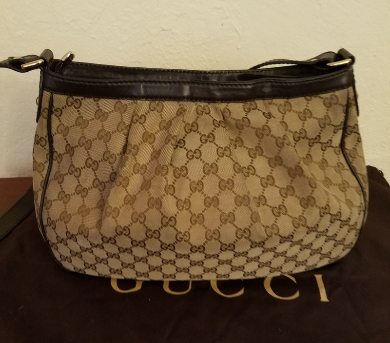 2b8d8f07c94 ... Authentic vintage Gucci shoulder bag crafted of canvas and leather.  Features gold tone hardware